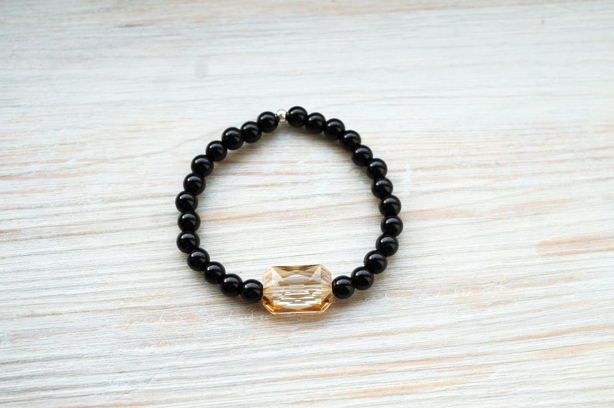 fd62aa5ea61 Esileht»Käevõrud»Käevõru musta oonüksi ja kuldse Swarovski kristalliga,  hõbedast metallosad. Previous
